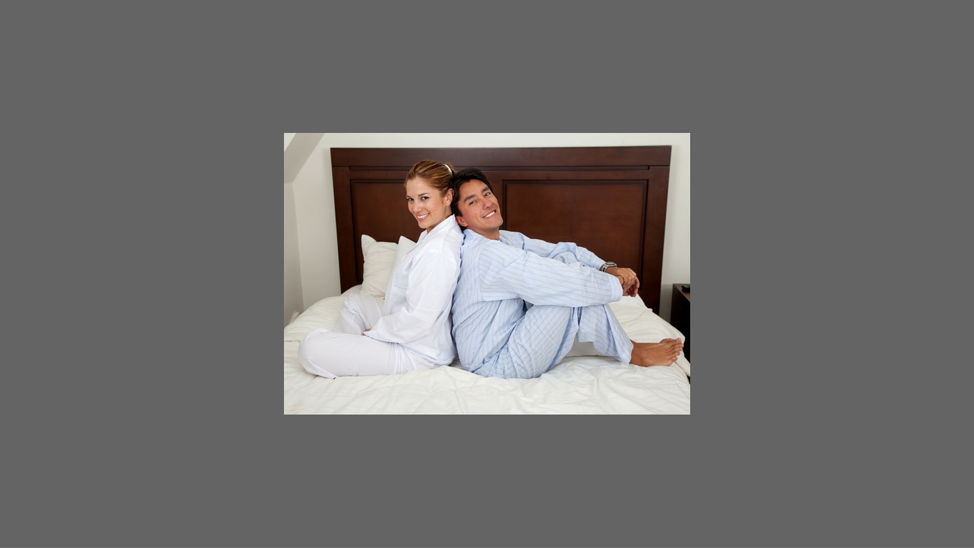 Couple Sitting Back to Back in Bed